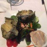 Delish food. Salad, fish and grilled artichoke.