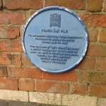Blue plaque with information relating to the bar
