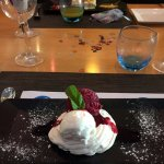 Meringue ice cream berry coulis