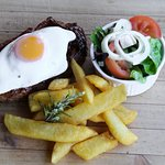 Steak, egg, garlic butter, chips & salad
