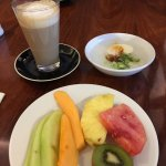 tall latte, congee, and fruit