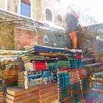 Old book store, with flooded damaged books stacked as staircase
