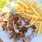 Small portion of souvlaki with tzatziki and fries. Very good.