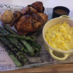 half a rotisserie chicken with creamed corn and asparagus