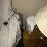 The only plug socket to use the kettle was by the bed