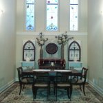 Church alter transformed into residential dining room.