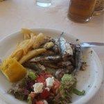Chicken souvlaki and grilled sardines