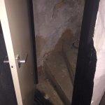 Open attic door from bedroom