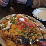 Irish Nachos--perfect steak fries topped with shepherds pie meat, scallions, peas and diced toma