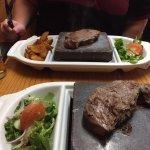 Kangaroo and Zebra Steaks served on a rock plate.