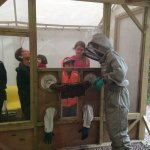 holding a bee frame in the beekeeping demo