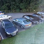 Green Mondeo, Black Insignia and Black Passat taking 5 spaces between them.