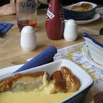 Unusual serving dishes with generous serving of custard