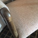Chair in room with a sample of dark carpet