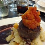 Angus fillet with rustic potatoes, wine sauce and caramelised tomatoes