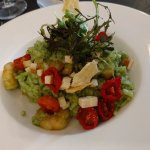 Green Risotto with goat chees, tomatoes and sweet olives
