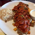 Iskender: Gyro Kebob Served Over Sautéed, Crunchy Pita with Sour Cream and Rice
