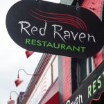 The sign above the door of the Red Raven Restaurant