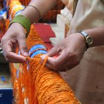 While tying the saffron-colored holy thread, devotees share their problems with the Ganesha