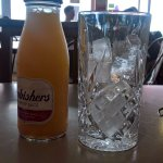 Just an orange juice to start, please. Certainly, would you like that with ice?