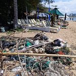 Piles of garbage along side the Paradise Suites Beach Club