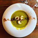 Pea Soup with Oxtail tortellini, bacon crumbs and truffle oil