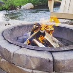 One of the 4 fire pits that are offered for a small fee on the hotel grounds along the stream.