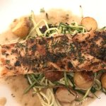 Delicious salmon, atop zucchini pasta and grilled potatoes