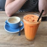 Scrambled eggs and salmon, vegan breakfast, flat white and carrot, orange and ginger juice