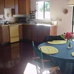 Spacious equipped kitchen and dining area.