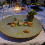 Grilled scallop wrapped in Parma ham with asparagus mousse and passion balsamic vinegar dressing