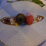 Chocolate sphere, raspberry sorbet, caramel sauce, white chocolate emulsion