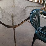 rusty patio furniture and one chair was broken