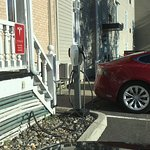 A Tesla charger. Don't know enough about EVs to know if it's compatible with other models.