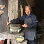 Mr. Jo grinding soy beans into soy milk.