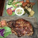 Grilled Pork Chop with grill potatoes and a salad