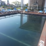 pool painted in tarry substance, safety hazard for children--depth lines difficult to see
