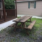 Old rotted picnic table outside of cabin