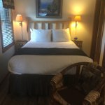Queen bed and chairs