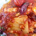 Paccheri Pasta with tomatoes, olives, and salted cod fish