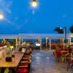 Dining by the sea, under the bluest of skies