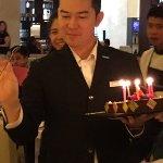 "Khun ""M"" bringing the cake"
