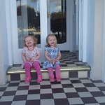 Our daughters on the front steps of the Wildings Hotel