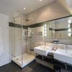 Bathroom of Suite with separate shower, bath and natural daylight.