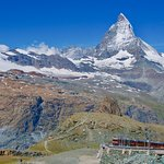 Take the Gornergrat rail up and walk down to Riffelalpl and then take the train again down