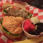 Pecan Chicken Salad on Croissant with fruit.