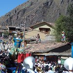 Procession of the cross at the Pentecost fiesta, with Saqra devil-dancers on the roofs