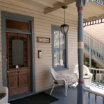 Welcoming front porch of main house