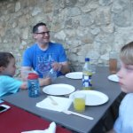 Grand children eagerly anticipating pizza on our 1st night in France