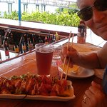 My wife Tess enjoying Tuna Nachos with a cold Islamarada Draft Beer!